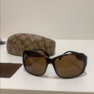 Coach tortoise sunglasses.